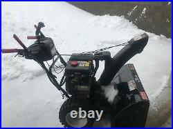 Used two stage black gas-powered snow blower from Craftsman